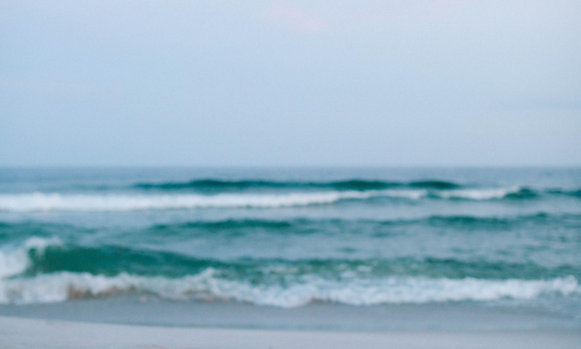 beach waves unwind reflect