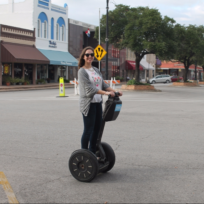 Girl riding segway in Lockhart, Texas